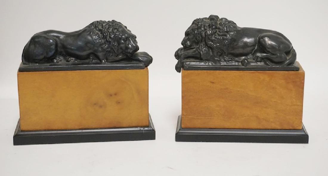 PAIR OF METAL LION BOOKENDS ON WOODEN BASES. 8 1/2 IN