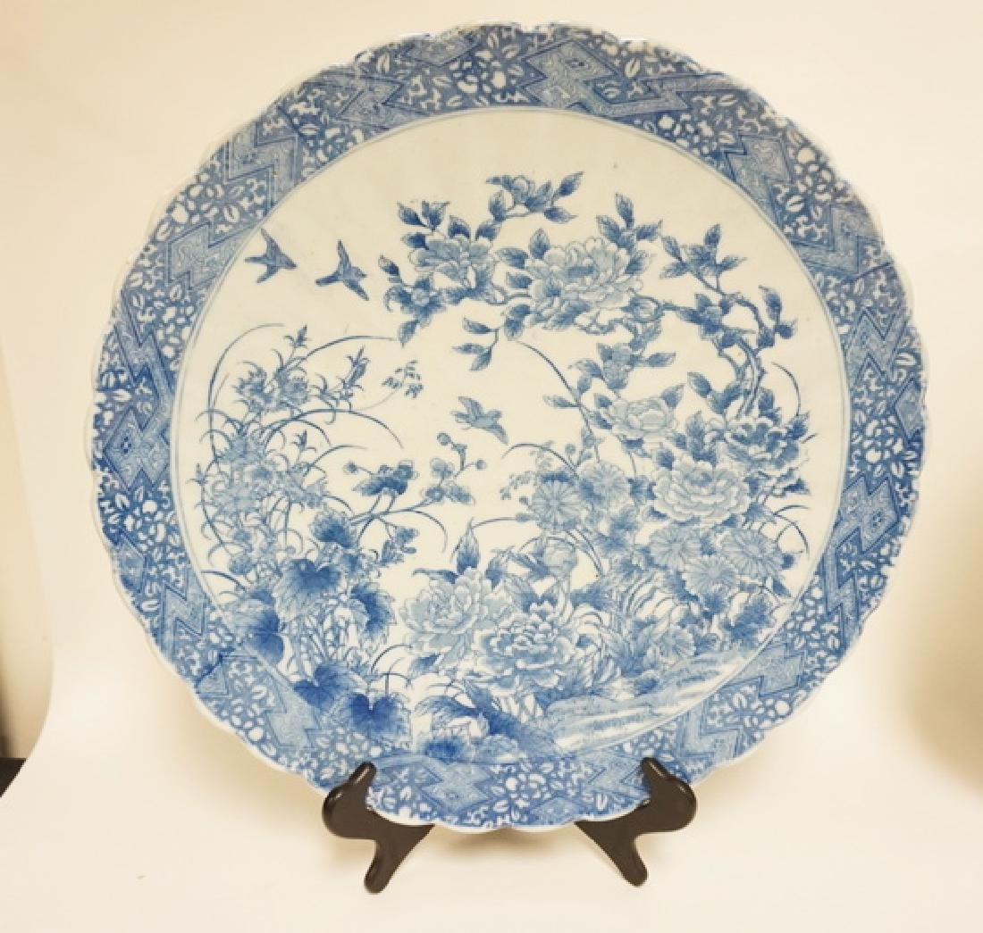 BLUE AND WHITE ASIAN CHARGER WITH FLOWERS AND BIRDS IN