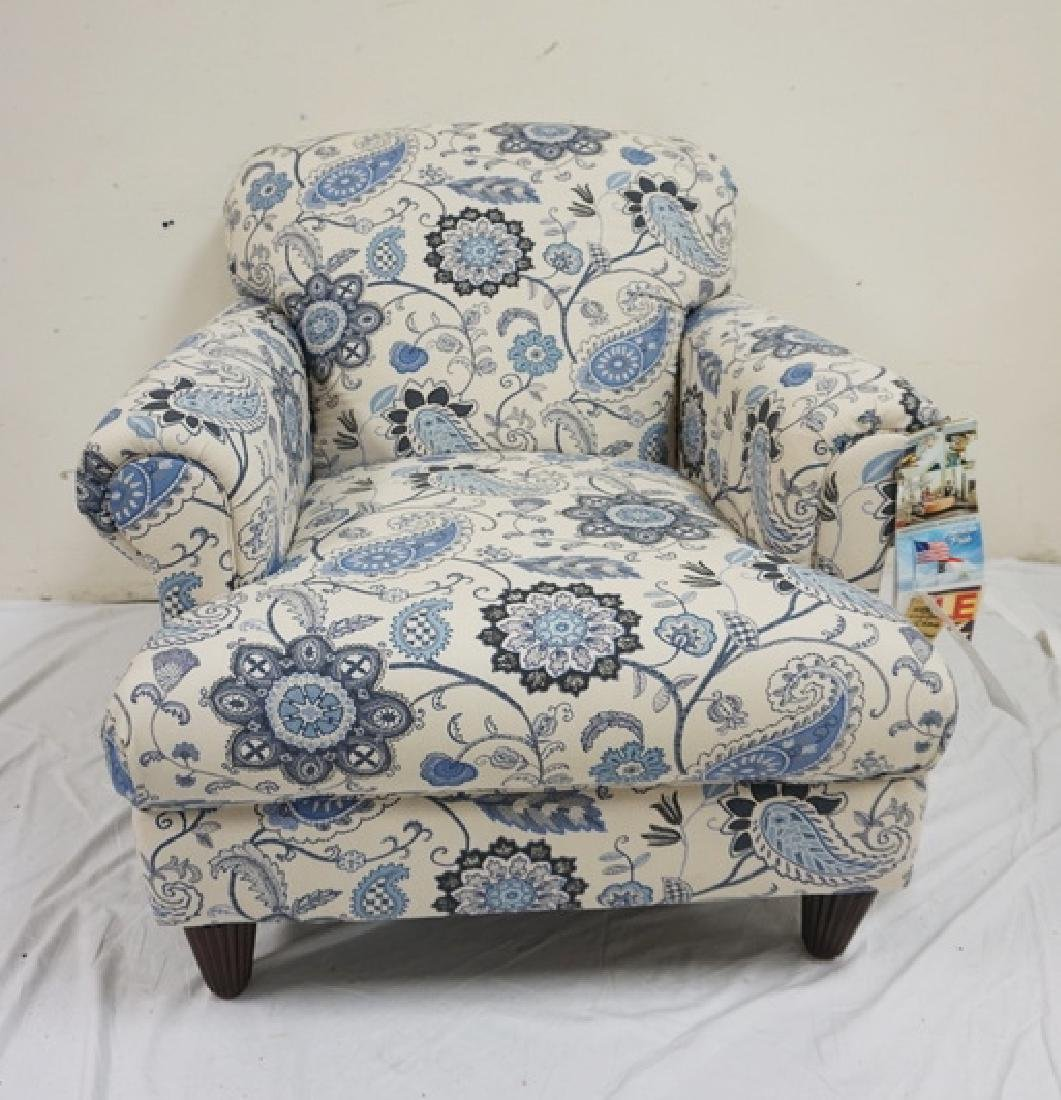 KLAUSSNER BLUE AND WHITE PAISLEY UPHOLSTERED ARM CHAIR.