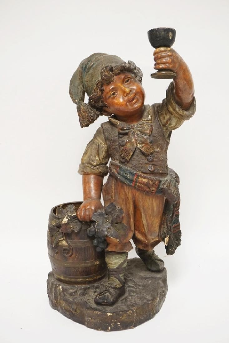LARGE GERMAN POTTERY FIGURE OF A BOY HOLDING A CHALICE