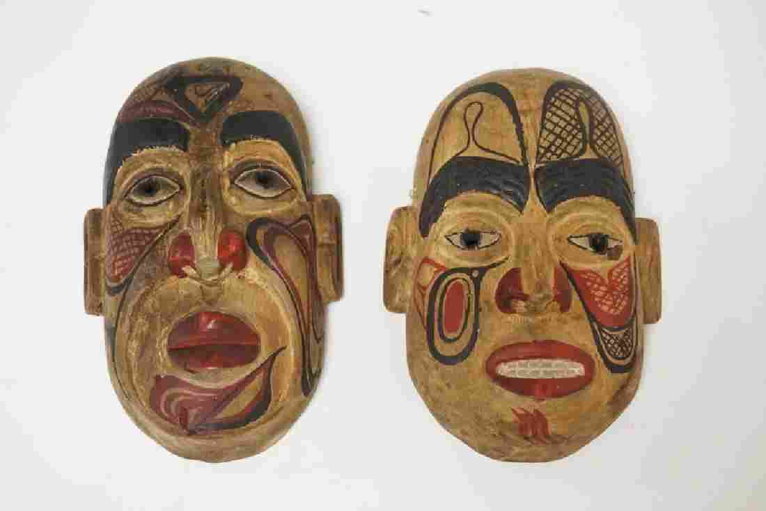 PAIR OF CARVED AND HAND PAINTED MASKS FROM KAIEN