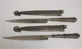PAIR OF ORNATE SILVER PLATED LETTER OPENERS. 9 1/4