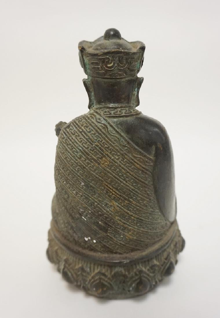 ASIAN BRONZE SEATED FIGURE HOLDING A RUYI. BASE CEMENT - 2
