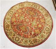 ROUND ORIENTAL RUG MEASURING 5 FEET IN DIA
