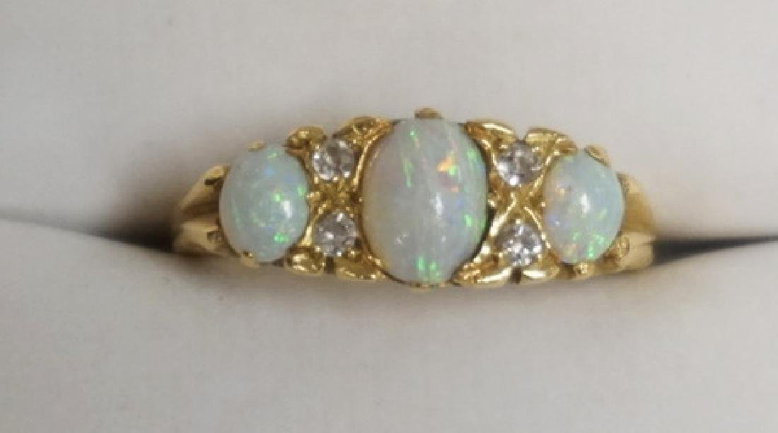 14K GOLD OPAL RING WITH DIAMOND ACCENTS. 2.50 DWT.