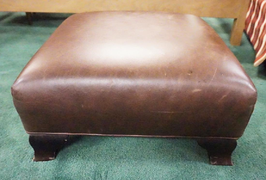 LEATHER FOOTSTOOL.
