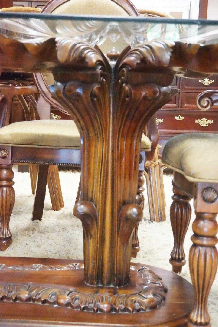 DINING TABLE WITH 4 CHAIRS. THE TABLE HAS AN ORNATELY - 3