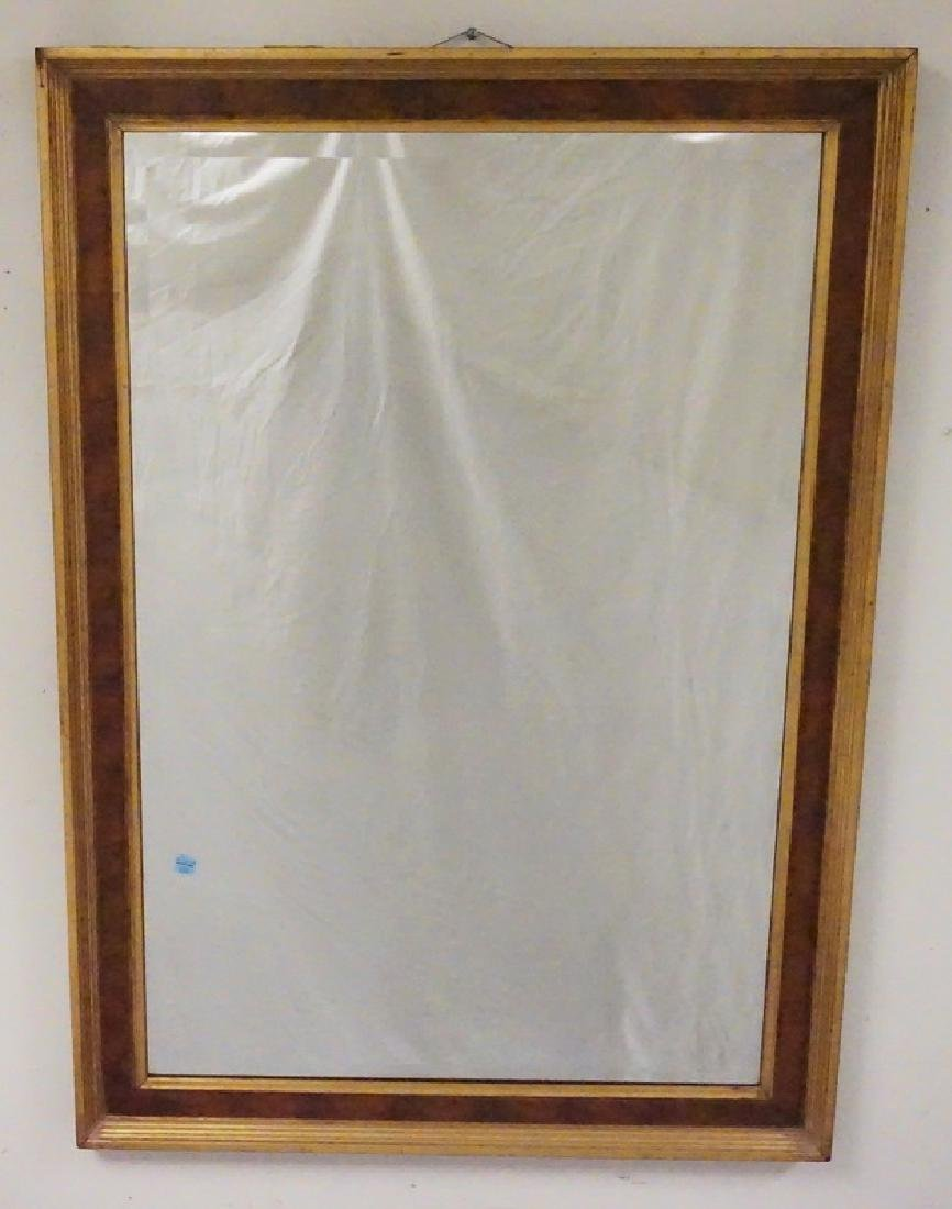 MIRROR WITH A BURLED AND GOLD GILT FRAME. 29 X 41