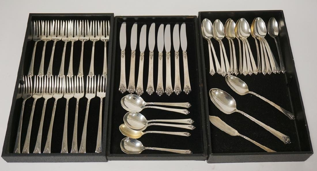 STERLING SILVER FLATWARE SET. 49 PIECES. CASTLE ROSE BY