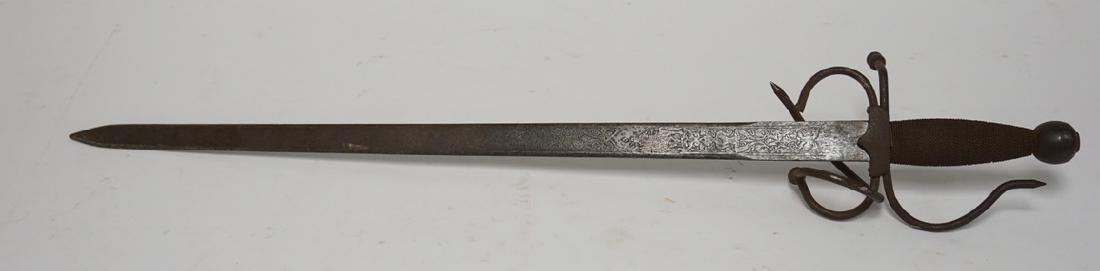 SPANISH SHORT SWORD WITH A KNIGHT ENGRAVED ON THE BLADE