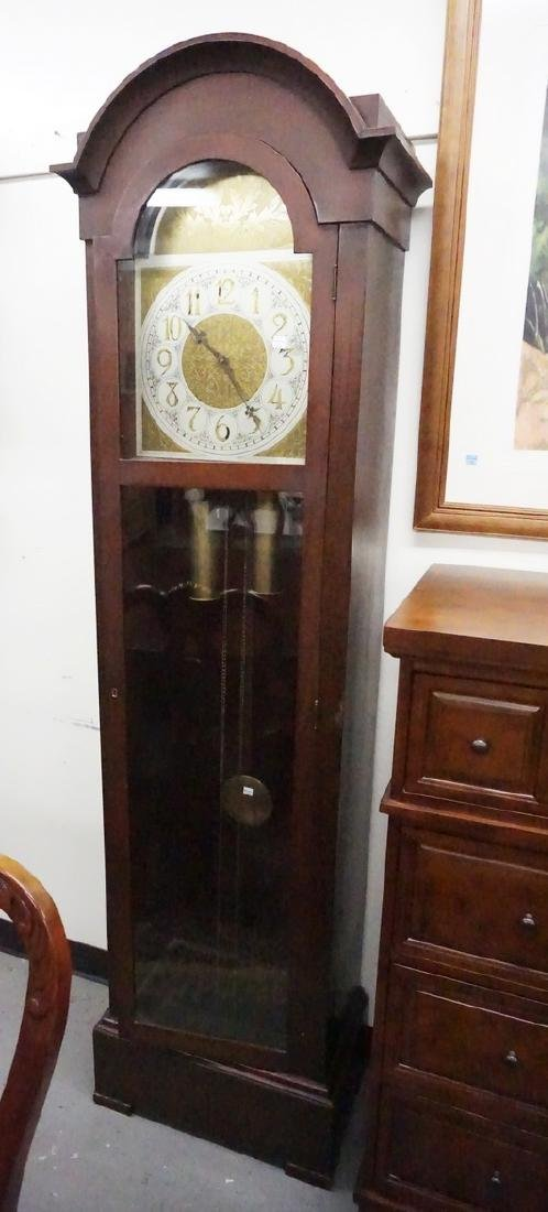 TALL CASE MAHOGANY CLOCK WITH AN ORNATE BRASS FACE. 81