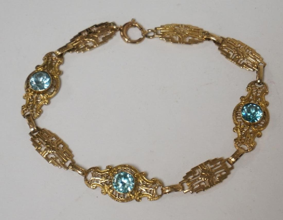 GOLD BRACELET WITH LIGHT BLUE STONES. LIKELY 9K GOLD.