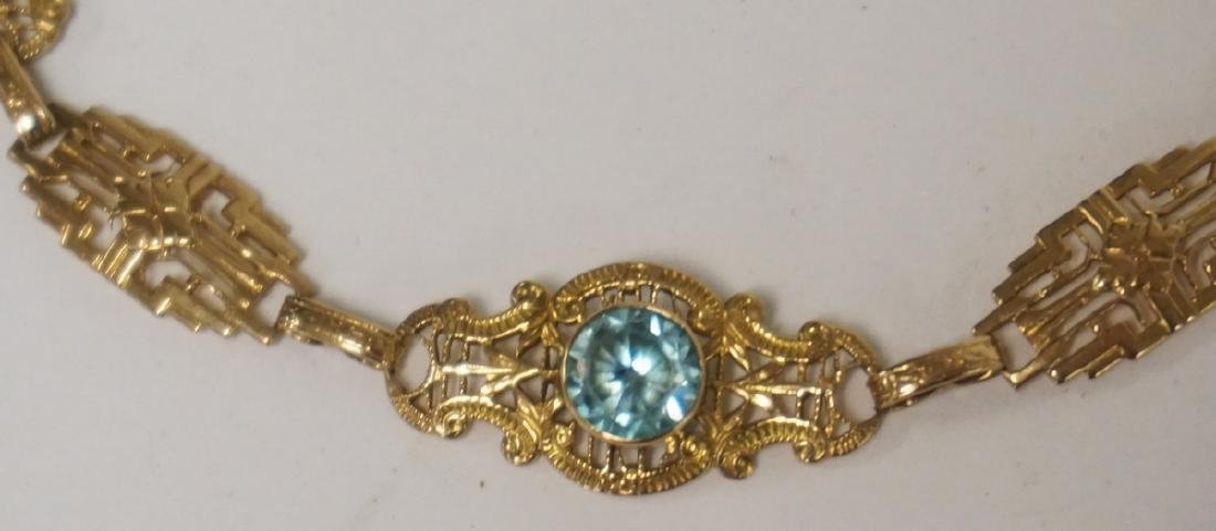 GOLD BRACELET WITH LIGHT BLUE STONES. LIKELY 9K GOLD. - 2
