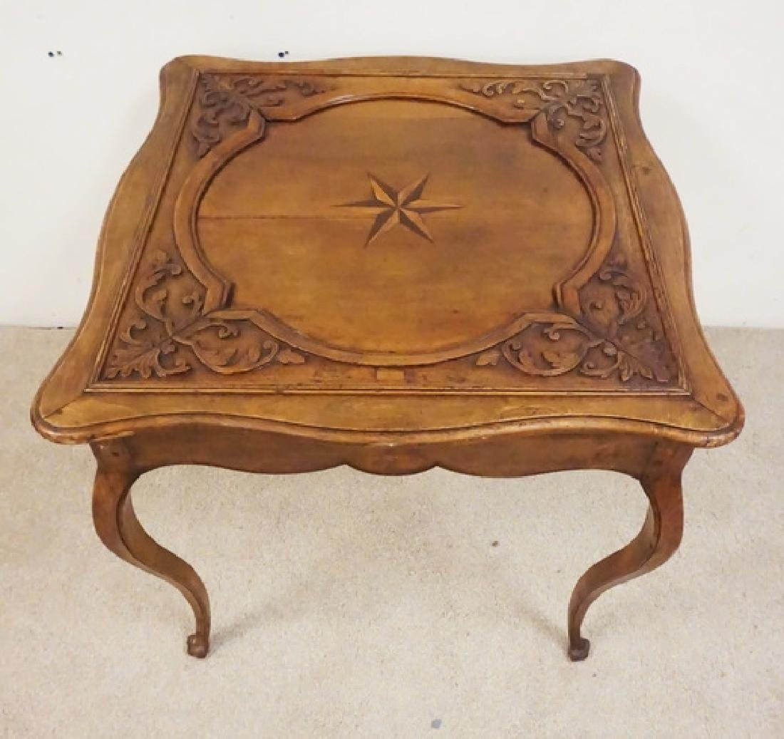 CARVED AND INLAID TABLE WITH A SCROLL CUT SKIRT. - 2