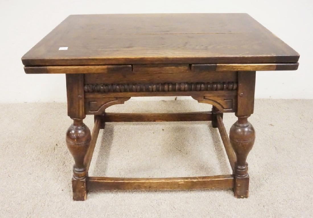 SMALL OAK TABLE WITH PULL OUT LEAVES