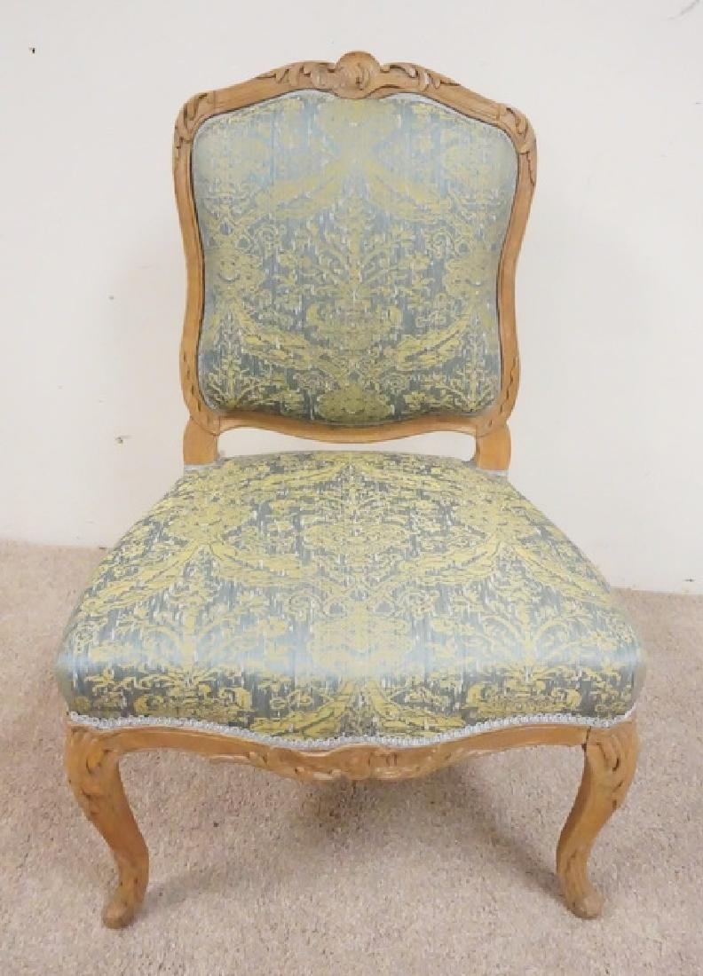 CARVED AND UPHOLSTERED SIDE CHAIR