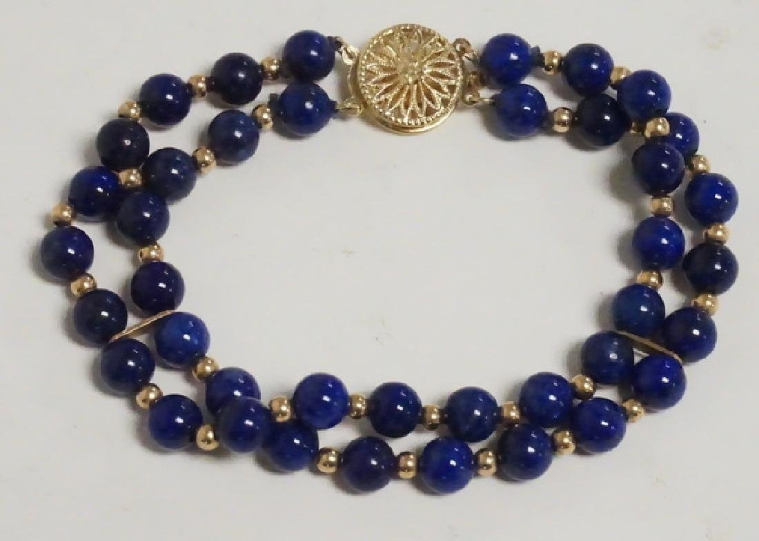 14K GOLD AND LAPIS BEAD BRACELET.