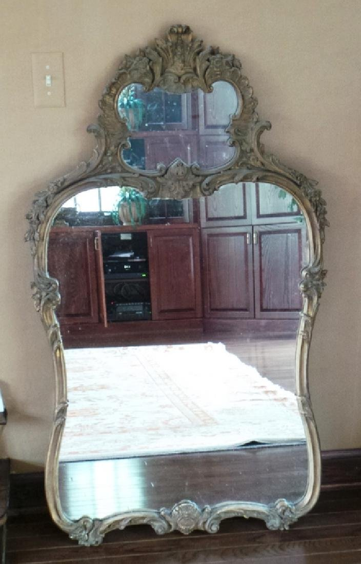 ORNATELY CARVED MIRROR