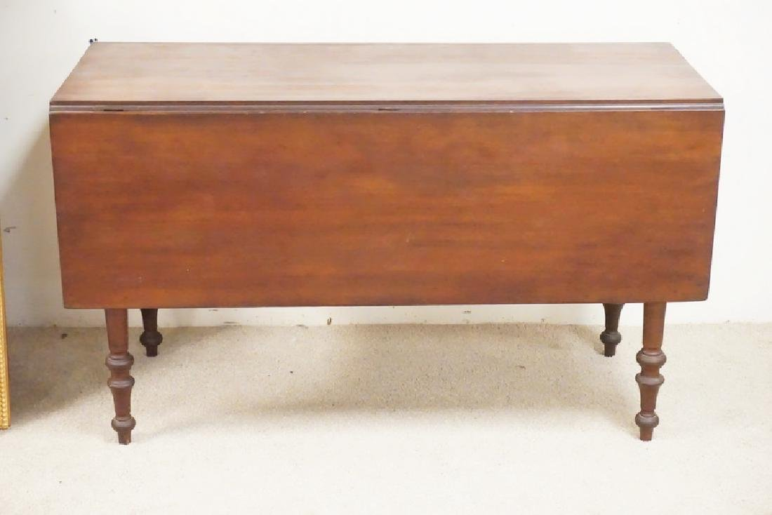 ANTIQUE CHERRY DROP LEAF TABLE WITH TURNED LEGS.