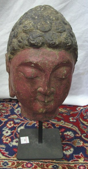 16: CARVED STONE BUDDHA HEAD MOUNTED ON A METAL BASE