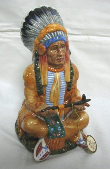 1009: ROYAL DOULTON INDIAN W/PIPE; TITLED *THE CHIEF*