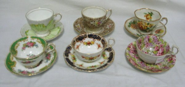 1021: LOT OF 6 DIFFERENT DECORATED CUP & SAUCER SETS