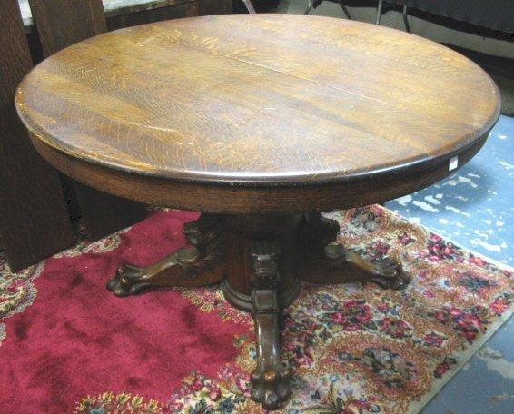 1305: 48 IN ROUND OAK TABLE W/LION HEADS & CLAW FEET