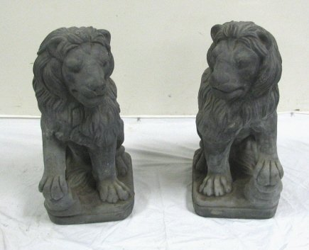 7: PAIR OF CARVED STONE LIONS