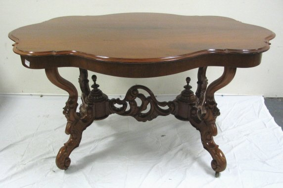 24: CARVED MAHOGANY DINING TABLE