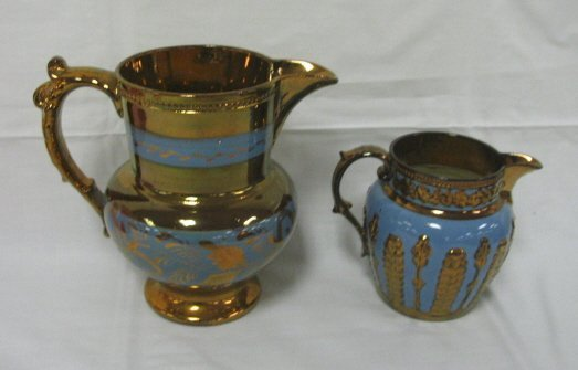 1007: 2 BLUE DECORATED COPPER LUSTER CREAMERS