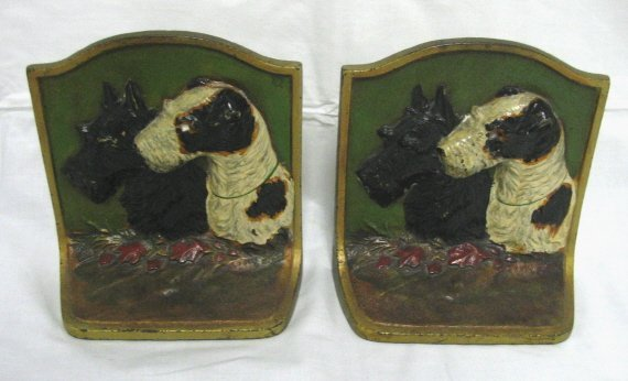 1010: PR OF PAINT DECORATED CAST IRON BOOKENDS
