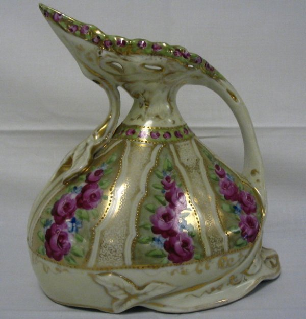 9: UNMARKED HP NIPPON EWER; 7 1/2 IN H, 7 IN W