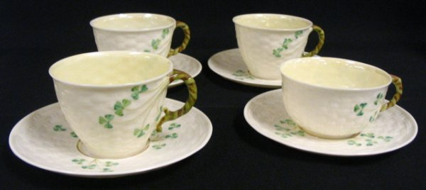 11: FOUR BELLEEK CUPS & SAUCERS, SHAMROCKS; GREEN MARK;