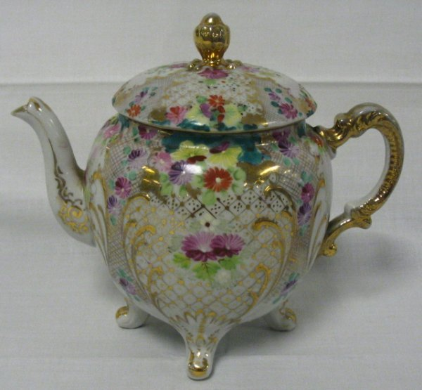 16: HAND PAINTED ORIENTAL TEAPOT, FOOTED, 6 1/4 IN H