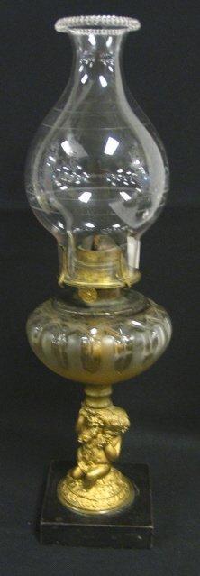 2001: KEROSENE LAMP W/FIGURAL METAL STEM