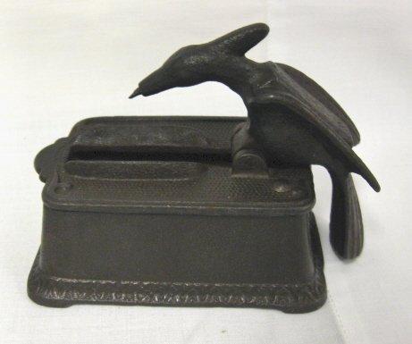 16: FIGURAL IRON MATCH BOX, BIRD PICKS UP A MATCH