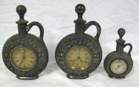 2005: CLOCK LOT; PAIR OF DECANTER FORM SILVER PLATED &