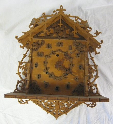 2006: CLOCK; WOODEN CARVED & FRETWORK HANGING WALL CLOC