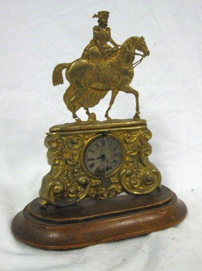 2176: CLOCK; BRASS EMBOSSED SHELF CLOCK OF WOMAN & HORS