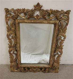 GILT MIRROR IN ORNATE FRAME