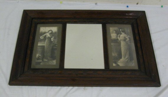 23: CARVED OAK TRIPTYCH FRAME; HAS PRINTS OF LADIES ON