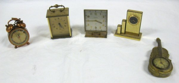 1006: 5 CLOCK LOT W/BUILDING, CELLO; LARGEST IS 6 5/8 I