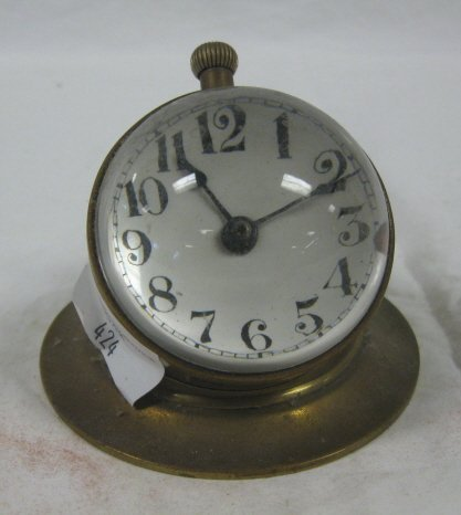 1019: BRASS PAPERWEIGHT CLOCK W/BUBBLE GLASS; 2 1/2 IN