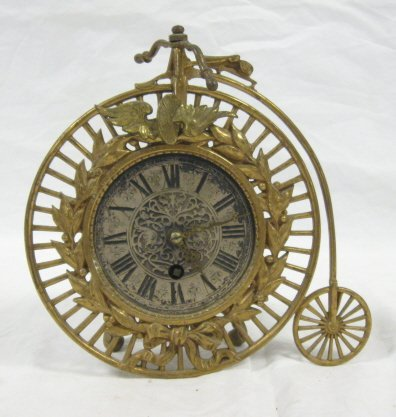 1037: BICYCLE FORM CLOCK; 8 IN H, 8 1/4 IN L; ALL CLOCK