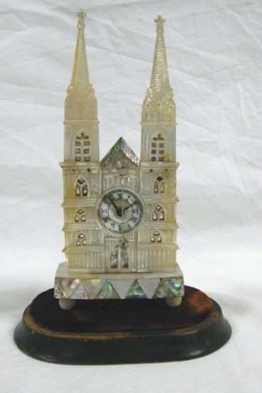 1053: SMALL MOTHER OF PEARL CATHEDRAL CLOCK UNDER GLASS