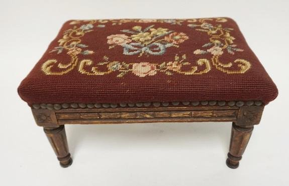SMALL CARVED STOOL WITH NEEDLEPOINT TOP.