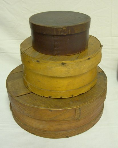 7: GROUP OF 4 WOODEN PANTRY BOXES; LARGEST IS 15 IN DIA