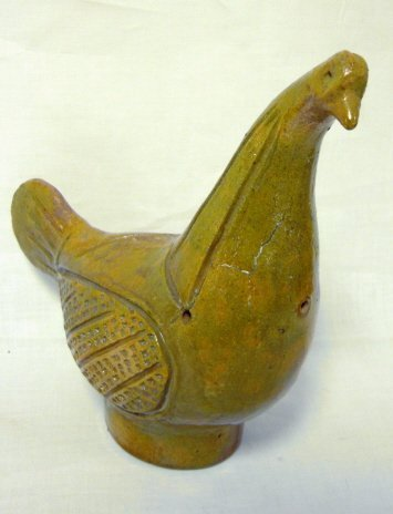 1008: RED POTTERY BIRD; HAS A HAIRLINE IN THE NECK; SLI