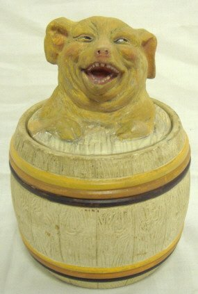 1022: LAUGHING PIG IN A BARREL TOBACCO JAR; 6 1/4 IN