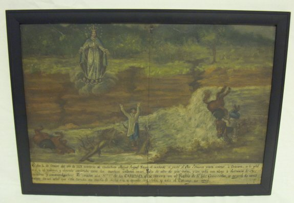 1023: ICON ON TIN; STORY IS WRITTEN AT THE BASE; HAS A